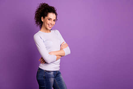 Profile photo of self-confident wavy hairstyle business lady with crossed arms company representative wear pullover and jeans isolated purple color background