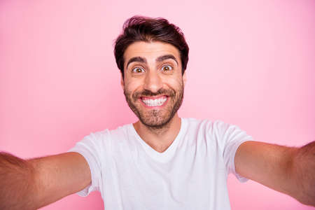 Close up photo of positive cheerful middle eastern man make selfie have fun on spring weekends vacation feel content rejoice wear trend outfit isolated over pastel color background