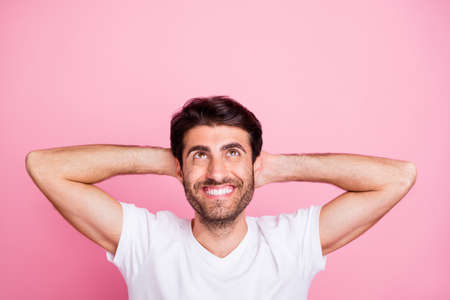 Top above high angle photo of positive cheerful middle eastern man feel calm dream have rest on summer holidays dream wear summertime outfit isolated over pastel color background Stock Photo