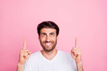 Close up photo of funky positive cheerful middle eastern man promoter point index finger show promo ads direct way wear trend modern clothes isolated over pink color background