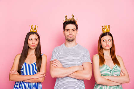 Portrait of pensive ladies with tiara on their long foxy ginger haircut look at arrogant guy wearing striped t-shirt dress skirt isolated over pink background