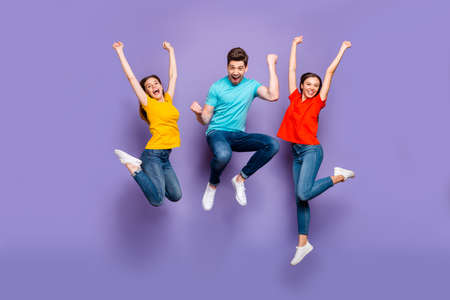 Full length size body photo of three funny funky ecstatic excited delightful, buddies having fun on weekend isolated violet background