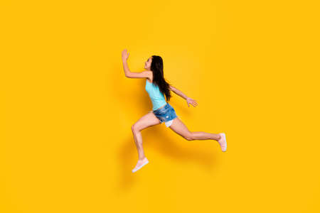Full length body size photo of cheerful cute nice shopaholic hurrying up for shopping mall weaing jeans denim shorts turquoise tank-top isolated bright color background