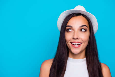 Closeup photo of pretty lady looking wondered to empty space wear nice white hat and tank-top isolated blue color background