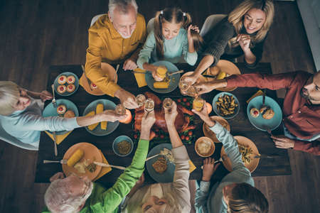 Top above high angle view of nice lovely big full charming cheerful friendly family eating lunch brunch homemade tasty yummy meal dishes drinking beverage congratulate in house restaurant indoors Stok Fotoğraf