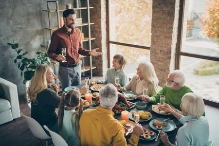 Portrait of nice cheery big full family brother sister granddaughter grandson enjoying generation gathering domestic festive dad saying toast grateful in modern loft industrial style interior house Stok Fotoğraf