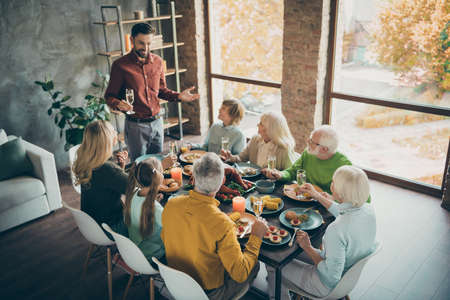 Portrait of nice cheery big full family brother sister granddaughter grandson enjoying generation gathering tradition dad saying toast congrats gratefulness modern loft industrial style interior house Stok Fotoğraf