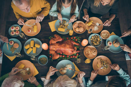 Top above high angle view of nice big full family eating lunch homemade fresh delicacy domestic turkey meal dishes gathering meeting season tradition celebrating harvest in house restaurant indoors Stok Fotoğraf