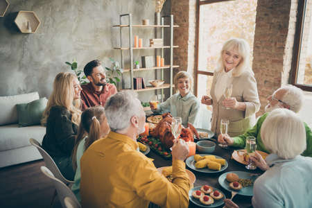 Portrait of nice cheerful big full family brother sister eating domestic brunch feast generation gathering tradition grandma saying toast congrats greeting modern loft industrial style interior house Stok Fotoğraf