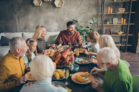 Portrait of nice charming cheerful big full family company group brother sister talking meeting gathering eating domestic meal dishes brunch gratefulness modern loft industrial style interior house