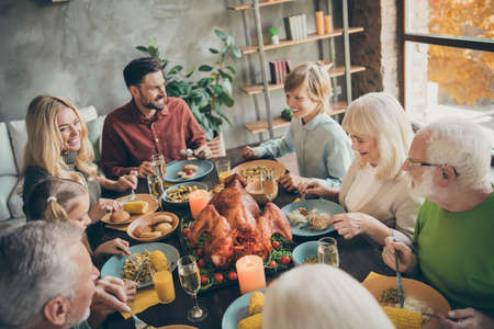 Portrait of nice charming cheerful cheery big full family brother sister eating domestic brunch lunch feast entertainment delicious meal dishes in modern loft industrial style interior house Stok Fotoğraf