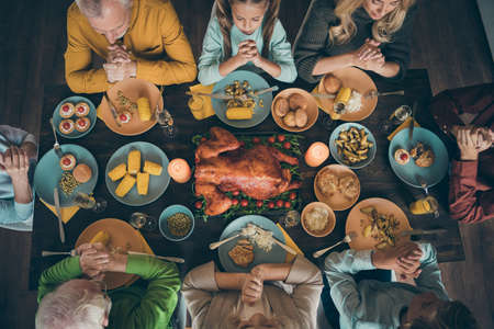 Cropped top above high angle view of nice big full peaceful idyllic family praying before eating brunch meal dishes served table grateful for good harvest blessing tradition in house restaurant Stok Fotoğraf