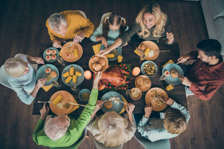Top above high angle view of nice lovely big full cheerful friendly family brother sister having lunch eating homemade tasty yummy meal dishes gathering tradition in house restaurant indoors