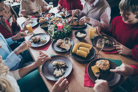 Top above and high angle view photo of festive table filled with various food meals enjoying leisure with x-mas atmosphere spirit son and daughter in company of mature senior people wife husband Stok Fotoğraf