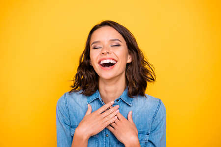 Portrait of positive cheerrful funny funky girl hear joke laugh ha-ha-ha wear youth outfit isolated over yellow color background