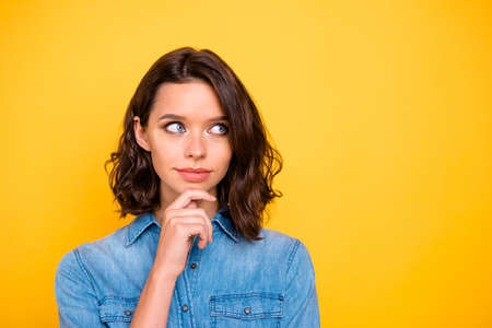 Close up photo of serious focused freelancer youth businresswoman think about project have dilemma try solve job question wear trendy clothes isolated over yellow color background 写真素材