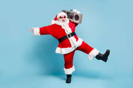 Full length body size view of his he nice cool fat cheerful cheery glad excited overjoyed bearded Santa dancing having fun isolated over blue turquoise pastel color background Standard-Bild - 131544084