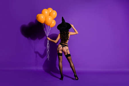 Rear back behind view full length body size view of nice perfect shape black brunette wavy-haired lady posing festal balls isolated bright vivid shine vibrant violet purple lilac color background