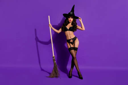 Full length body size view of her she nice attractive stunning chic magnificent sporty wavy-haired lady posing with broom isolated on bright vivid shine vibrant violet purple lilac color background