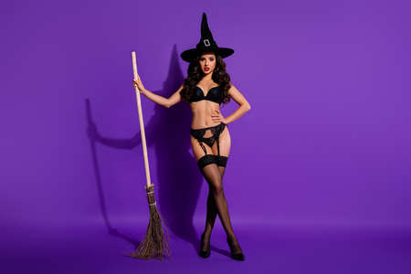 Full length body size view of her she nice attractive stunning alluring wavy-haired lady posing with broom isolated on bright vivid shine vibrant violet purple lilac color background Standard-Bild