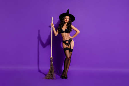 Full length body size view of her she nice attractive stunning enticing perfect wavy-haired lady with broom isolated on bright vivid shine vibrant violet purple lilac color background