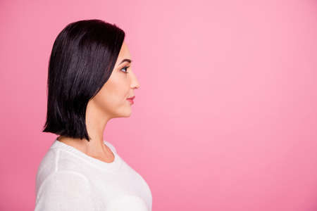 Profile photo of charming business lady looking empty space listening boss ready to do tasks wear white pullover isolated pink color background