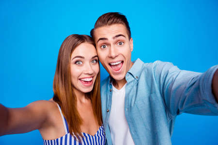 Self-portrait of her she his he two nice attractive lovely charming cheerful cheery glad excited people embracing isolated over bright vivid shine vibrant blue color background Stok Fotoğraf