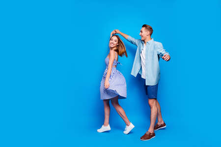 Full length body size view of her she his he two nice attractive charming lovely cheerful partners dancing spinning waltz isolated over bright vivid shine vibrant blue turquoise color background