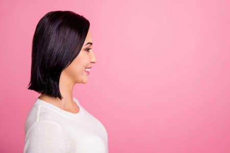 Profile photo of charming business lady looking empty space listening boss attentively wear white pullover isolated bright pink color background