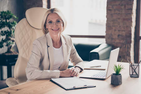 Photo of cheerful professional entrepreneur listening to employee trying to get job at her corporation
