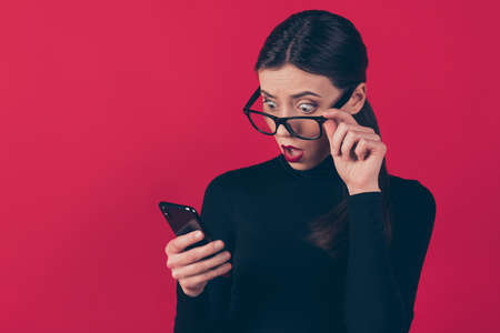 Close-up portrait of her she nice-looking attractive pretty impressed, shocked girl using cell online shopping incredible outlet isolated on maroon burgundy marsala red pastel color background