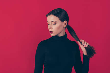 Close up photo of gorgeous elegant lady hold her pigtail posing want date attract, wealthy rich millionaire man wear trendy outfit isolated over red color background