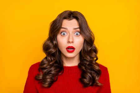 Photo of curly wavy feared terrified horrified astonished girlfriend emotional with frightful face expression seeing something negatively, unbelievable isolated over yellow bright color background