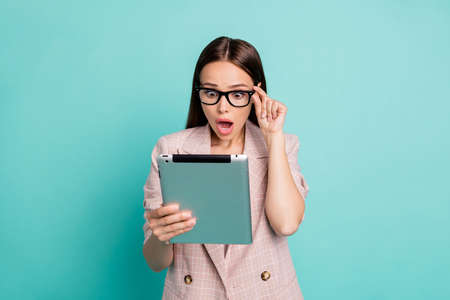 Portrait of her she nice-looking attractive lovely pretty astonished straight-haired lady touching specs reading bad news isolated over bright vivid shine blue green teal turquoise background