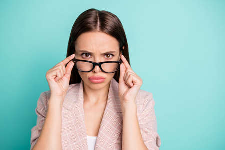Close-up portrait of her she nice attractive lovely pretty glamorous annoyed irritated strict straight-haired lady touching specs isolated over bright vivid shine blue green teal turquoise background
