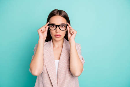 Portrait of her she nice-looking attractive lovely gorgeous pretty winsome content attentive straight-haired lady touching specs isolated over bright vivid shine blue green teal turquoise background
