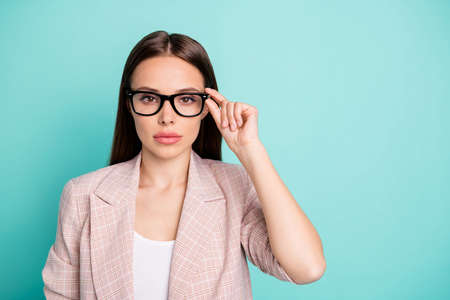 Close-up portrait of her she nice-looking attractive lovely lovable winsome content straight-haired lady touching specs isolated over bright vivid shine blue green teal turquoise background Stock Photo
