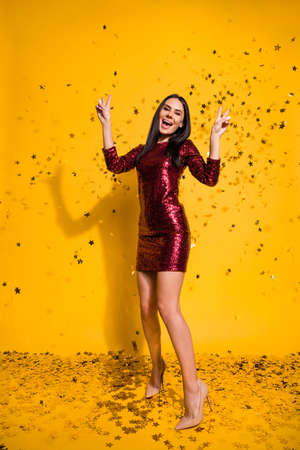 Vertical full length body size view of nice attractive lovely charming gorgeous slim fit slender cheerful girl showing v-sign dancing isolated on bright vivid shine vibrant yellow color background Standard-Bild - 131268156