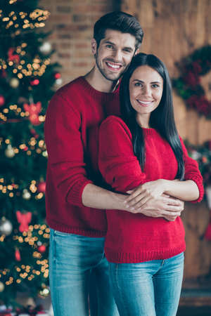 Portrait of romantic romance lovely couple hug near christmas tree in the morning, enjoy party noel event in house with x-mas illumination lights indoors