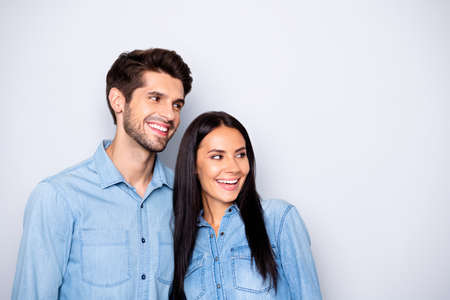 Close-up portrait of his he her she nice attractive charming cute lovely cheerful cheery, glad couple wearing casual looking aside isolated over light white gray pastel color background Reklamní fotografie