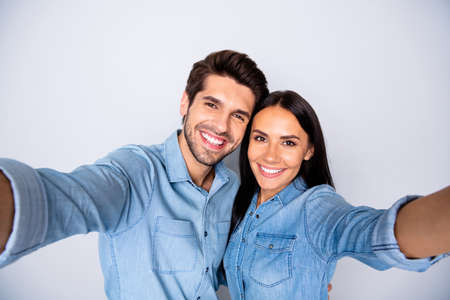 Self-portrait of his he her she nice attractive charming cute cheerful cheery winsome, couple married spouses isolated over light white gray pastel color background