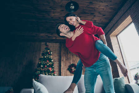 Low below angle view of his he her she nice attractive lovely charming, cheerful cheery friendly married spouses spending vacation having fun in decorated loft industrial wood style interior