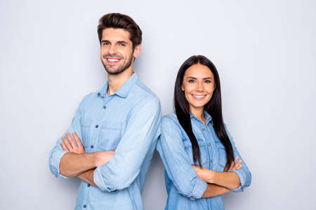 Close-up portrait of his he her she nice attractive cheerful cheery content couple partners leaders wearing casual folded arms standing back to back isolated over light white pastel color background