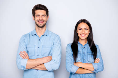 Close-up portrait of his he her she nice attractive lovely charming cheerful cheery content couple partners wearing casual folded arms isolated over light white pastel color background Banco de Imagens
