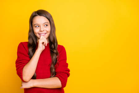 Portrait of minded cunning sly model girl think have plans choose decide trick for her friends wear style red pullover isolated over yellow color background