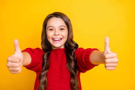 Close up photo of positive cheerful emotion funky kid show thumb up enjoy ads give feedback choice decisions recommend promo wear style lifestyle jumper isolated over yellow color background