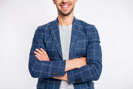 Cropped portrait of his he nice attractive cheerful businessman partner leader ceo boss chief head of HR department wearing blue checked blazer folded arms isolated over light white pastel background Banco de Imagens - 131359851