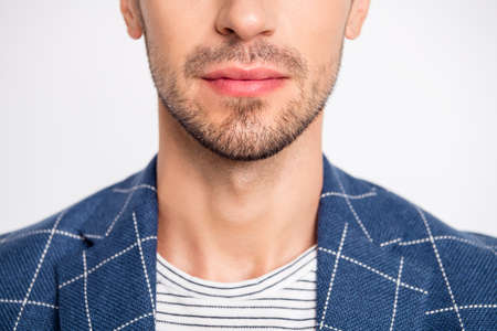 Close-up cropped view portrait of his he nice attractive bearded calm content well-groomed businessman wearing modern checked blazer isolated over light white pastel background