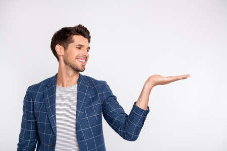 Portrait of his he nice attractive cheerful cheery content businessman agent broker wearing checked blazer holding invisible object on palm isolated over light white pastel background Standard-Bild - 131359914