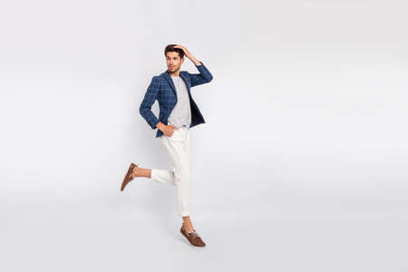 Full length body size view of his he nice attractive luxurious content director wearing checked blazer modern clothing jumping fixing hair hairstyle isolated over light white pastel background